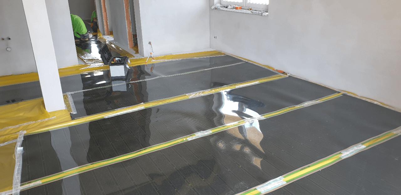 Podlahové vytápění developerského projektu pomocí topné fólie